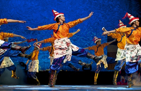 CHENGDU - SEP 28: chinese Tibetan ethnic dancers perform on stage at experimental theater.Sep 28,2010 in Chengdu, China.