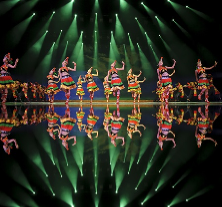 CHENGDU - SEP 26: chinese ethnic dancers of Yi nationality perform on stage at JIAOZI theater.Sep 26,2010 in Chengdu, China. Stock Photo - 13161798