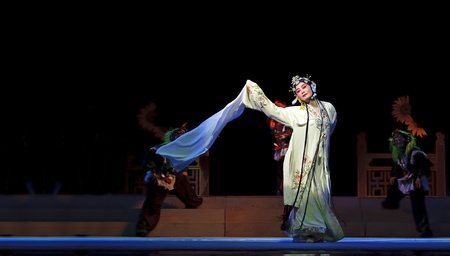 CHENGDU - JUN 6: Mulian Drama of Chinese Qi opera performer make a show on stage to compete for awards in 25th Chinese Drama Plum Blossom Award competition at Experimental theater.Jun 6, 2011 in Chengdu, China. Stock Photo - 13692286