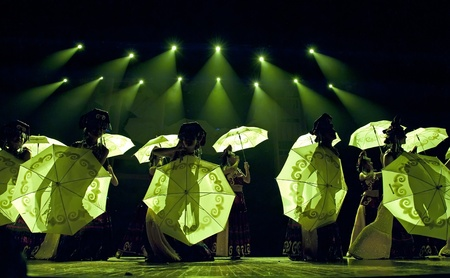 CHENGDU - SEP 26: chinese Yi ethnic dancers perform on stage at JIAOZI theater.Sep 26,2010 in Chengdu, China. Stock Photo - 13692307