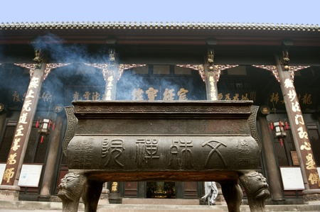 incense altar in buddhist temple photo