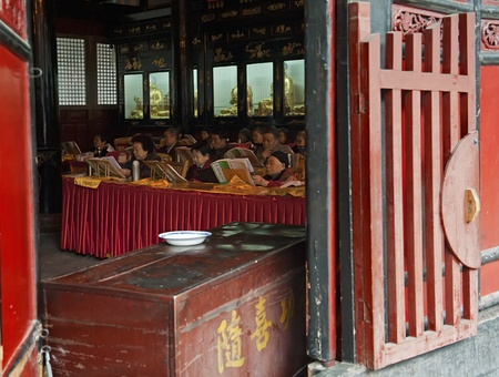 sutras: CHENGDU - APR 8: Buddhists are chanting sutras in Wenshu Monastery on Apr 8, 2012 in Chengdu, China. Editorial