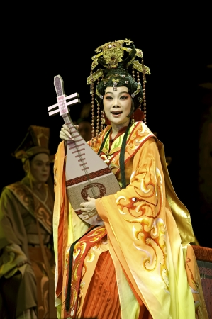 CHENGDU - JUN 6: Chinese Gaojia Opera performer make a show on stage to compete for awards in 25th Chinese Drama Plum Blossom Award competition at Jinsha theater.Jun 6, 2011 in Chengdu, China. Chinese Drama Plum Blossom Award is the highest theatrical awa