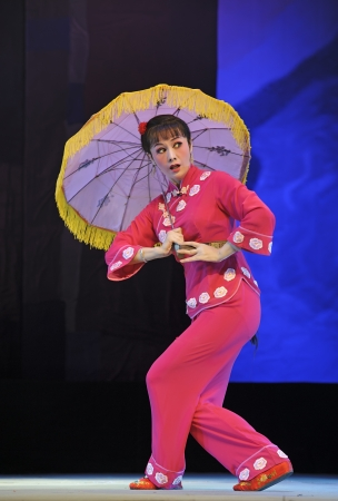CHENGDU - JUN 8: Chinese Chu opera performer make a show on stage to compete for awards in 25th Chinese Drama Plum Blossom Award competition at Experimental theater.Jun 8, 2011 in Chengdu, China. Chinese Drama Plum Blossom Award is the highest theatrical