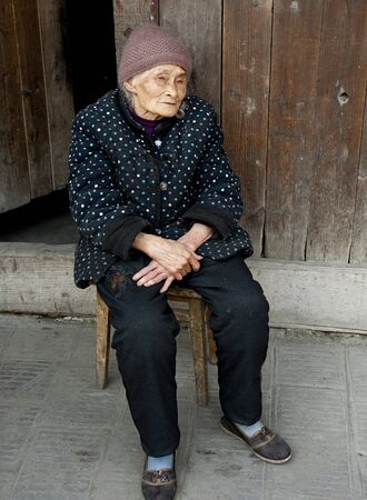 90: portrait of 90 years old woman in a town