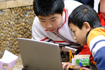 team ,partner and cooperation : boys concentrate on electronic design contest photo