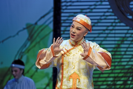 customary: CHENGDU - JUN 3: chinese Yue opera performer make a show on stage to compete for awards in 25th Chinese Drama Plum Blossom Award competition at Experimental theater.Jun 3, 2011 in Chengdu, China. Chinese Drama Plum Blossom Award is the highest theatrical  Editorial