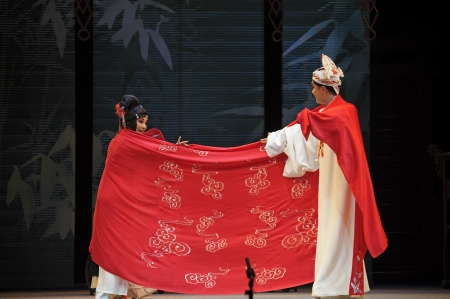 elegancy: CHENGDU - JUN 4: chinese Sichuan opera performer make a show on stage to compete for awards in 25th Chinese Drama Plum Blossom Award competition at Xinan theater.Jun 4, 2011 in Chengdu, China. Chinese Drama Plum Blossom Award is the highest theatrical awa