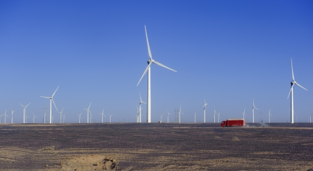 new energy source of wind power windmills in the wide Gobi Desert photo