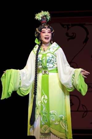 elegancy: CHENGDU - JUN 6: Chinese Gaojia Opera performer make a show on stage to compete for awards in 25th Chinese Drama Plum Blossom Award competition at Jinsha theater.Jun 6, 2011 in Chengdu, China. Chinese Drama Plum Blossom Award is the highest theatrical awa