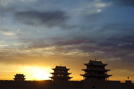 jiayuguan: Sunrise of the Jiayuguan Pass Tower in GanSu,China Editorial