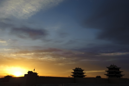 jiayuguan pass tower: Sunrise of the Jiayuguan Pass Tower in GanSu,China Stock Photo