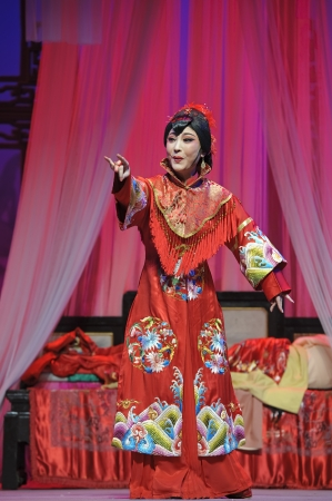 CHENGDU - JUN 3: chinese Yue opera performer make a show on stage to compete for awards in 25th Chinese Drama Plum Blossom Award competition at Experimental theater.Jun 3, 2011 in Chengdu, China. Chinese Drama Plum Blossom Award is the highest theatrical