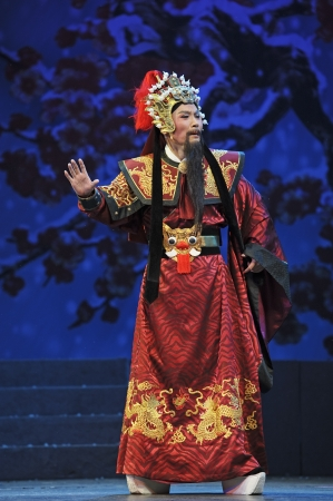 yue opera: CHENGDU - JUN 7: Chinese Yue opera performer make a show on stage to compete for awards in 25th Chinese Drama Plum Blossom Award competition at Shengge theater.Jun 7, 2011 in Chengdu, China. Chinese Drama Plum Blossom Award is the highest theatrical award