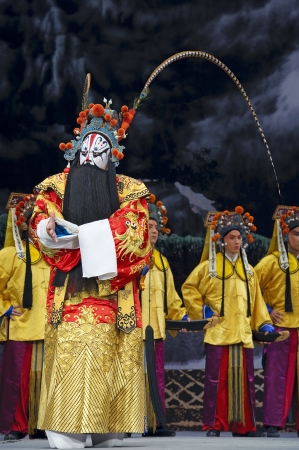 exaggerate: CHENGDU - MAY 30: chinese Beijing opera performer make a show on stage to compete for awards at Shengge theater in 25th Chinese Drama Plum Blossom Award competition.May 30, 2011 in Chengdu, China. Chinese Drama Plum Blossom Award is the highest theatrical Editorial