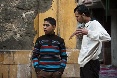 alexandria: ALEXANDRIA - JAN 27: arab boys talking in the street at Alexandria.Jan 27,2013 in Alexandria,Egypt. Editorial