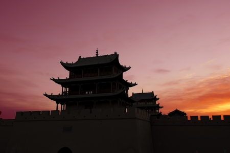 ancient relics: Sunrise of the Jiayuguan Pass Tower in GanSu,China Stock Photo