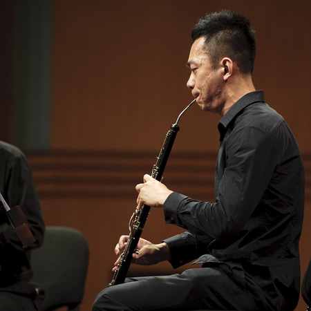 double reed: CHENGDU - JUN 20: musician performs English horn on wind music chamber music concert at odeum of Sichuan Conservatory of Music on Jun 20,2012 in Chengdu,China.
