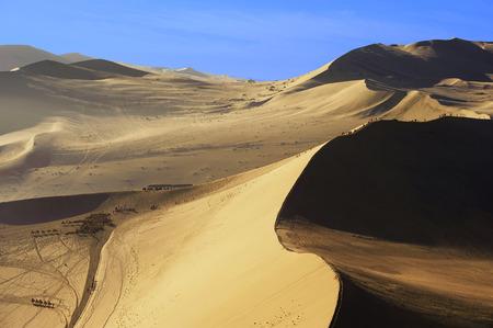 inhospitable: people in a sand dune ridge
