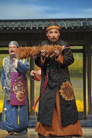 customary: CHENGDU - JUN 7: Chinese Yue opera performer make a show on stage to compete for awards in 25th Chinese Drama Plum Blossom Award competition at Shengge theater.Jun 7, 2011 in Chengdu, China. Chinese Drama Plum Blossom Award is the highest theatrical award