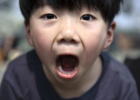 exaggerated: boy to make exaggerated facial expressions Stock Photo