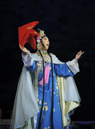 customary: CHENGDU - JUN 3: chinese Cantonese opera performer make a show on stage to compete for awards in 25th Chinese Drama Plum Blossom Award competition at Jinsha theater.Jun 3, 2011 in Chengdu, China. Chinese Drama Plum Blossom Award is the highest theatrical  Editorial