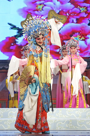 chinese opera: CHENGDU - JUN 4: chinese Hui opera performer make a show on stage to compete for awards in 25th Chinese Drama Plum Blossom Award competition at Xinan theater.Jun 4, 2011 in Chengdu, China. Chinese Drama Plum Blossom Award is the highest theatrical award i