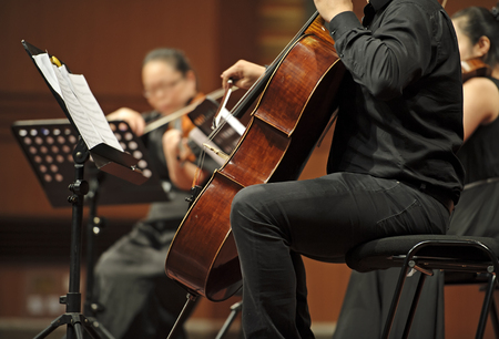 CHENGDU - JUN 20: violoncellist perform on wind music chamber music concert at odeum of Sichuan Conservatory of Music on Jun 20,2012 in Chengdu,China.