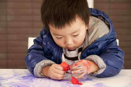 a cute baby is painting photo