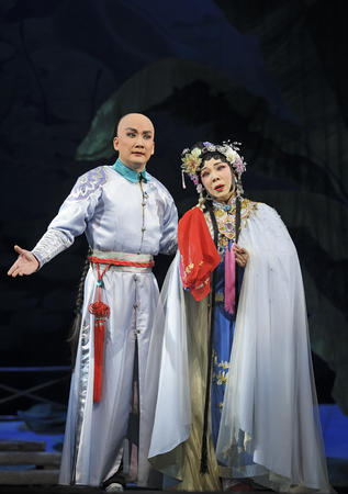 elegancy: CHENGDU - JUN 3: chinese Cantonese performer make a show on stage to compete for awards in 25th Chinese Drama Plum Blossom Award competition at Jinsha theater.Jun 3, 2011 in Chengdu, China. Chinese Drama Plum Blossom Award is the highest theatrical award  Editorial