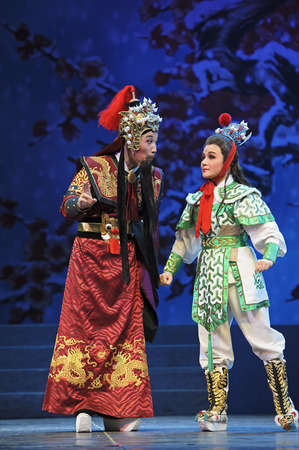 ch: CHENGDU - JUN 7: Chinese Yue performer make a show on stage to compete for awards in 25th Chinese Drama Plum Blossom Award competition at Shengge theater.Jun 7, 2011 in Chengdu, China. Chinese Drama Plum Blossom Award is the highest theatrical award in Ch Editorial