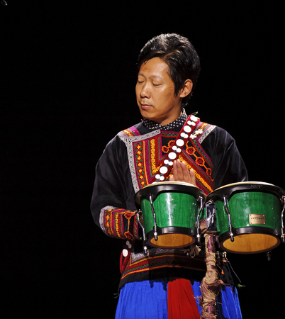 fervor: CHENGDU - SEP 26: chinese Yi ethnic musician perform on stage at JIAOZI theater.Sep 26,2010 in Chengdu, China.