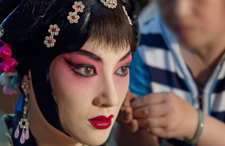 finery: chinese Sichuan actress painting face backstage Stock Photo