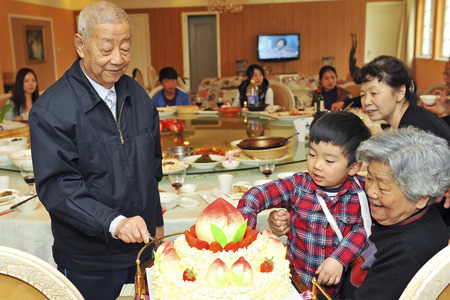 grandson and his grandparents in the birthday party photo