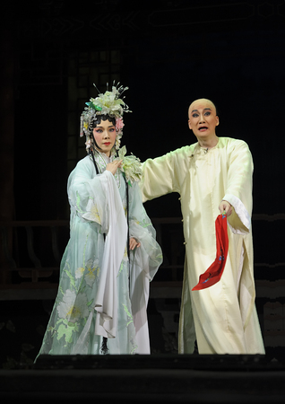 cantonese: CHENGDU - JUN 3: chinese Cantonese opera performer make a show on stage to compete for awards in 25th Chinese Drama Plum Blossom Award competition at Jinsha theater. Jun 3, 2011 in Chengdu, China. Editorial