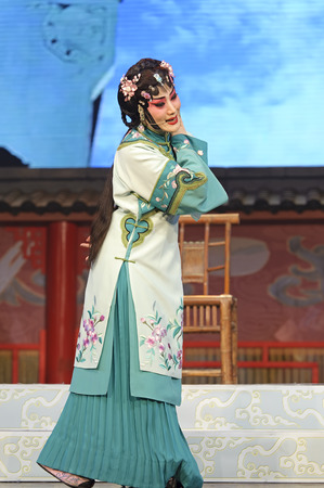 elegancy: CHENGDU - JUN 4: chinese Hui opera performer make a show on stage to compete for awards in 25th Chinese Drama Plum Blossom Award competition at Xinan theater. Jun 4, 2011 in Chengdu, China.
