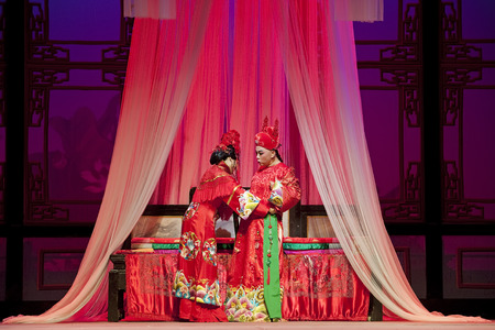 elegancy: CHENGDU - JUN 3: chinese Yue opera performer make a show on stage to compete for awards in 25th Chinese Drama Plum Blossom Award competition at Experimental theater. Jun 3, 2011 in Chengdu, China. Chinese Drama Plum Blossom Award is the highest theatrical Editorial