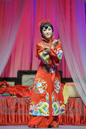 yue opera: CHENGDU - JUN 3: chinese Yue opera performer make a show on stage to compete for awards in 25th Chinese Drama Plum Blossom Award competition at Experimental theater.