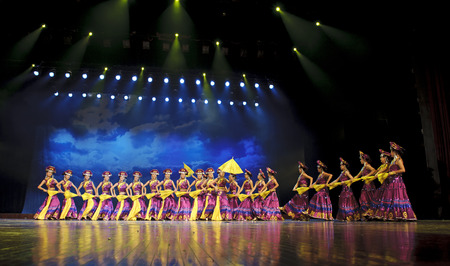 perform: CHENGDU - SEP 26: chinese Yi ethnic dancers perform on stage at JIAOZI theater.Sep 26,2010 in Chengdu, China.