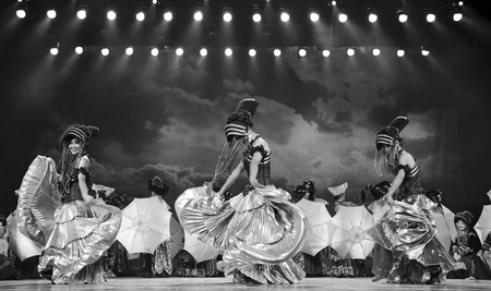 fervor: CHENGDU - SEP 26: chinese Yi ethnic dancers perform on stage at JIAOZI theater.Sep 26,2010 in Chengdu, China.