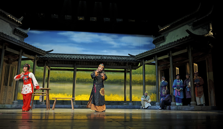 CHENGDU - JUN 7: Chinese Yue opera performer make a show on stage to compete for awards in 25th Chinese Drama Plum Blossom Award competition at Shengge theater.