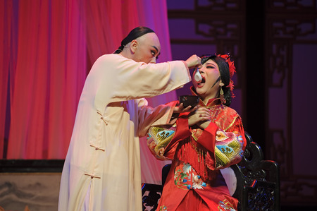 CHENGDU - JUN 3: chinese Yue opera performer make a show on stage to compete for awards in 25th Chinese Drama Plum Blossom Award competition at Experimental theater