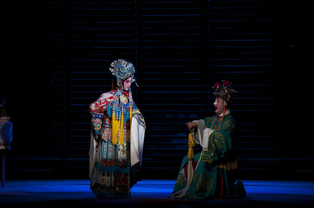 actors: CHENGDU - NOV 25: chinese traditional opera actors perform on stage at Jiaozi theater.Nov 25, 2014 in Chengdu, China.