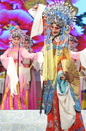finery: CHENGDU - JUN 4: chinese Hui opera performer make a show on stage to compete for awards in 25th Chinese Drama Plum Blossom Award competition at Xinan theater.Jun 4, 2011 in Chengdu, China. Chinese Drama Plum Blossom Award is the highest theatrical award i