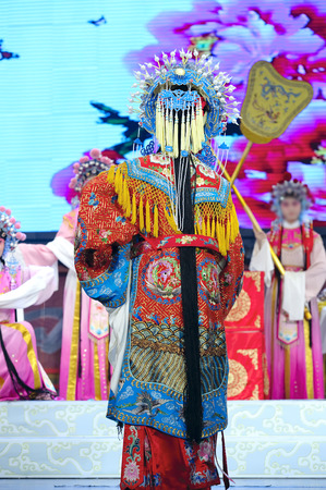 elegancy: CHENGDU - JUN 4: chinese Hui opera performer make a show on stage to compete for awards in 25th Chinese Drama Plum Blossom Award competition at Xinan theater.Jun 4, 2011 in Chengdu, China. Chinese Drama Plum Blossom Award is the highest theatrical award i