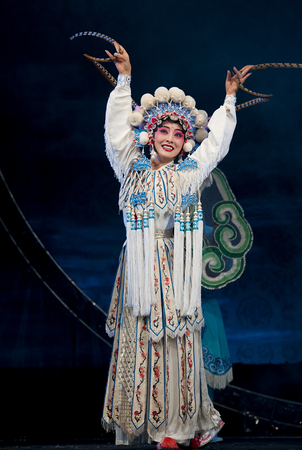 finery: CHENGDU - OCT 19: chinese traditional opera actress performs on stage at Sichuan opera theater.Oct 19, 2014 in Chengdu, China.