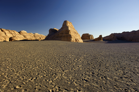 inhospitable: unique yadan earth surface in the Gobi Desert in Dunhuang,China Stock Photo