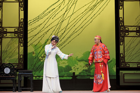 elegancy: CHENGDU - JUN 3: chinese Yue opera performer make a show on stage to compete for awards in 25th Chinese Drama Plum Blossom Award competition at Experimental theater