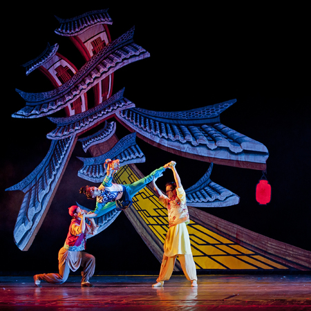 hoofer: CHENGDU - OCT 18: Chinese modern dancers perform contemporary dance on stage at JINCHENG theater on Oct 18, 2011 in Chengdu, China.