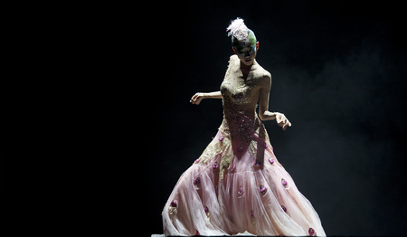 finery: CHENGDU - SEP 23: chinese famous dancer Yang Liping performs Peacock Dance on stage at Jincheng theater.Sep 23, 2012 in Chengdu, China.